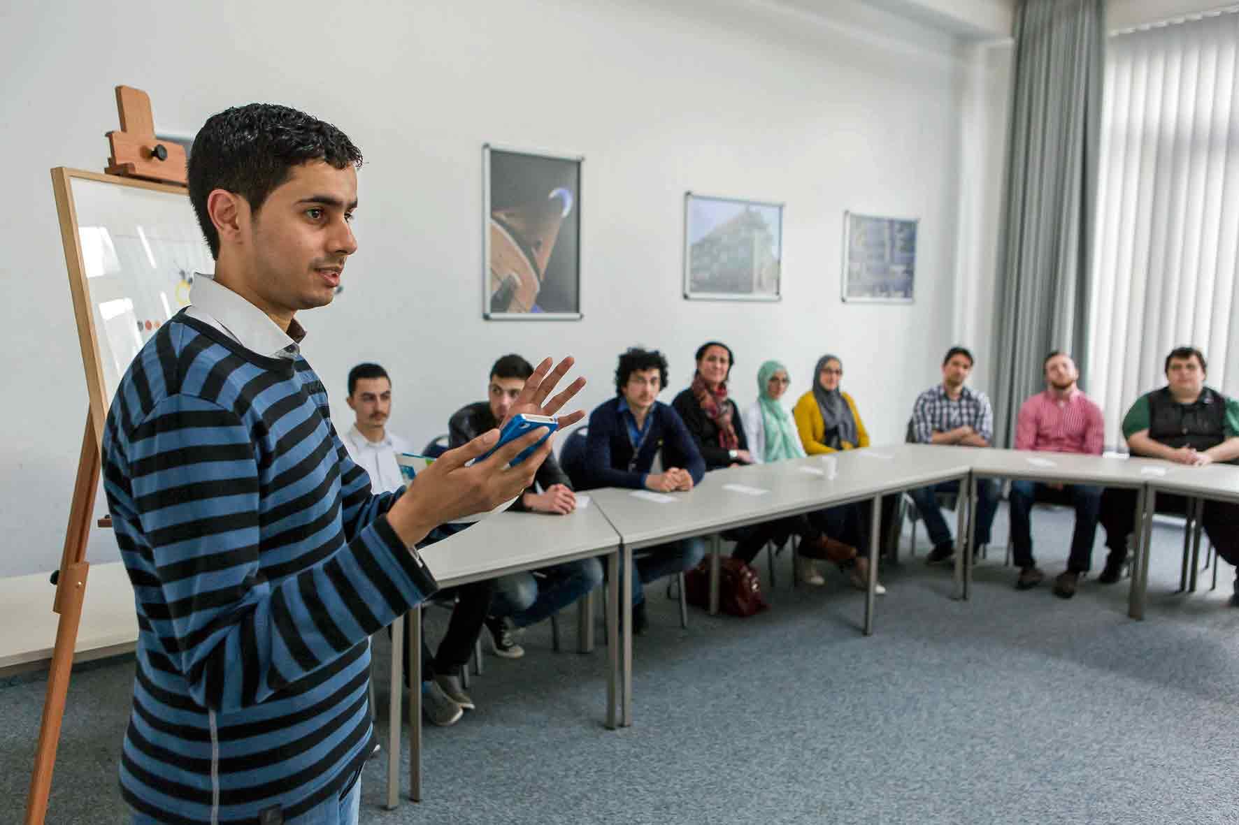 Teilnehmer eines Workshops